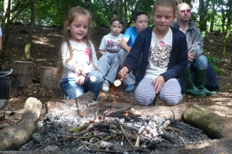 Toasting marshmallows at a Forest School
