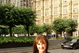 Rachel Giles outside the Houses of Parliament