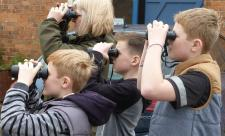 Children with binoculars c. Claire Huxley